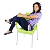 Young teenage girl smiling sitting on chair — Stock Photo