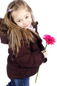 Little girl holding pink flower with winter jacket — Stock Photo