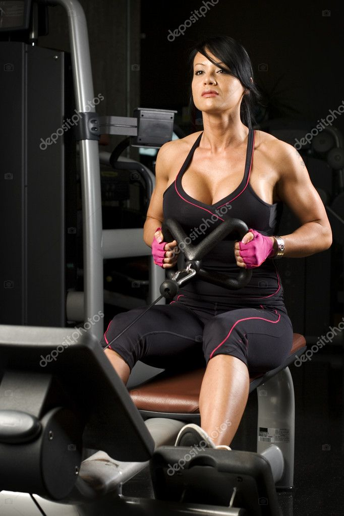 Asian woman working out on rower in gym — Stock Photo #7478505