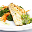 Fresh black cod on bed of broccoli and carrots — Stock Photo
