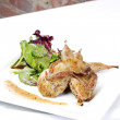 Quail with green salad - Stock Photo