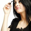 Beautiful young woman applying mascara — Stock Photo