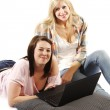 Happy friends surfing internet on a laptop - Isolated — Stock Photo