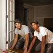 Multi ethnic team working on flooring — Stock Photo