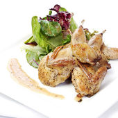 Quail with green salad — Stock Photo