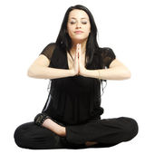 Young business casual woman in a lotus yoga position meditating — Stock Photo