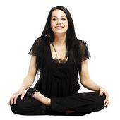 Unga business casual kvinna i en lotus yoga position leende — Stockfoto