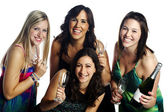 Group of confident young woman celebrating with a bottle of cham — Stock Photo