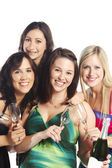 Attractive group of young happy girls with champagne — Stock Photo