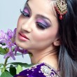 Beautiful indian woman with bridal makeup — Stock Photo