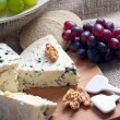 Blue cheese with walnuts and grapes — Stock Photo