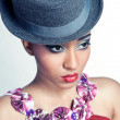 Closeup portrait of pretty young showgirl wearing a hat — Stock Photo