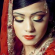 Beautiful indian girl with bridal makeup — Stock Photo #6946066