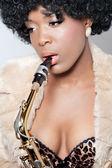 Closeup shot of a beautiful saxophone player — Stock Photo