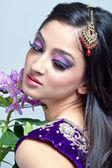 Beautiful indian woman with bridal makeup — Stock Photo