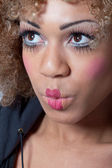 Woman with clown make-up looking surprised and intrigued — Stock Photo