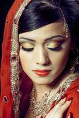 Beautiful indian girl with bridal makeup — Stock Photo