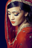 Beautiful indian girl with bridal makeup — Stock Photo