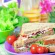 Sandwiches with bacon, chicken, lettuce and tomato with malted b — Stock Photo