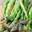 Fresh green asparagus on cutting board — Stock Photo