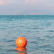 Waterpolo ball floating in the sea waters — Stock Photo