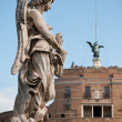 One of Bernini`s angels on Ponte Sant`Angelo - Stock Photo