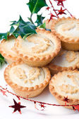 Traditional christmas mince pies on decorated table — Stock Photo