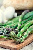 Fresh green asparagus on cutting board — Stock Photo