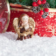 Christmas decorations praying angel with golden wings - Stock Photo