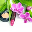 Stock Photo: Natural cosmetics concept: concealer and lipstick with bamboo