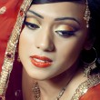Portrait of beautiful happy indian bride - Stock Photo