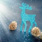 Christmas decorations: reindeer figure and golden cones, closeup — Stock Photo