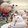 Two marshmallow snowmen biscuits with Chistmas decorations - Stock Photo