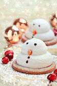 Two marshmallow snowmen biscuits with Chistmas decorations — Stock Photo
