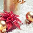Christmas composition with decorations: candle, baubles and star — Stock Photo