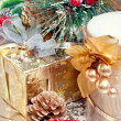 Christmas composition with gift box, candle and decorations — Stock Photo