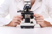 Scientist with microscope — Stock Photo