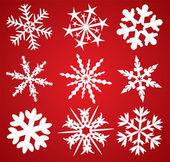 9 płatki śniegu — Wektor stockowy