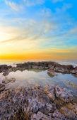 Beautiful, soft sunset on the background of rocks — Stock Photo