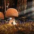Stock Photo: Fantasy image of toadstool houses in bluebell woods