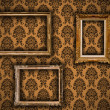 Stock Photo: Gilded vintage frames on damask wallpaper background