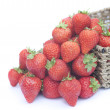 Fresh ripe juicy strawberries in rustic basket isolated on white — Stock Photo