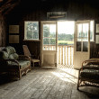 Nostalgic retro effect Summer Boat House with glowing sun - Stock Photo