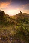 Romantic fantasy magical castle ruins against stunning vibrant s — Stock Photo