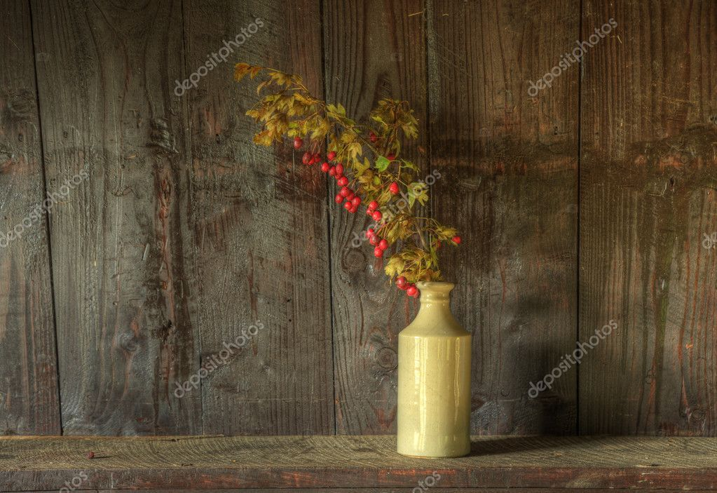 Still life image of dried flowers in rustic vase against weathered wooden background  Photo #7025861
