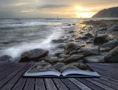 Creative concept image of seascape landscape coming out of pages — Stock Photo