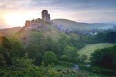 Romantic fantasy magical castle ruins against stunning sunrise — Stock Photo