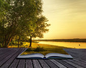 Magical fantasy style sunset in pages of magical book — Stock Photo