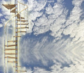 Spiral stairway to heaven glows against blue sky and reflection — Stock Photo