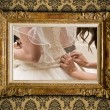 Wedding image in antique gilded frame on vintage damask style wa — Stock Photo